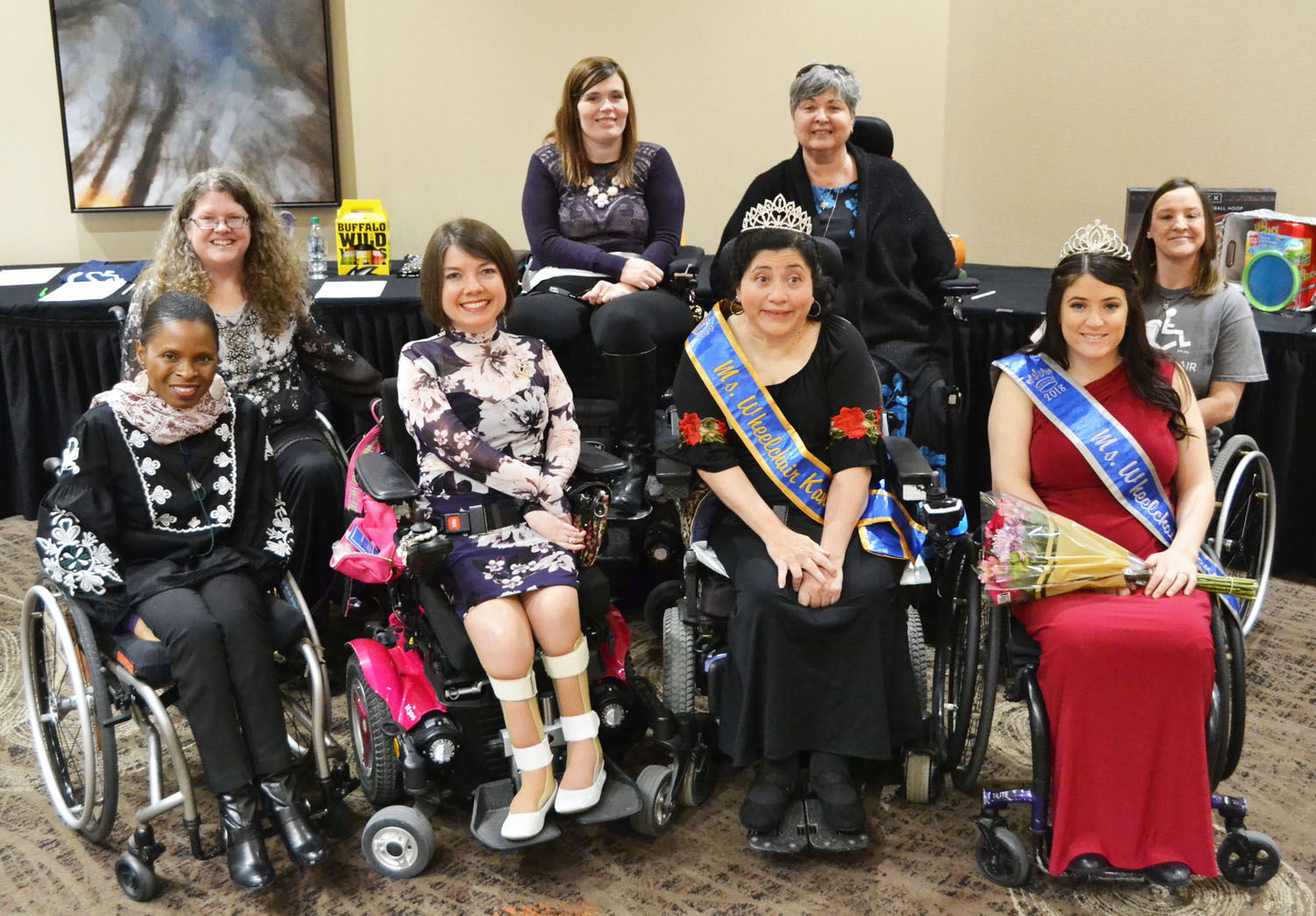 A group of about 10 titleholders gather for a photo