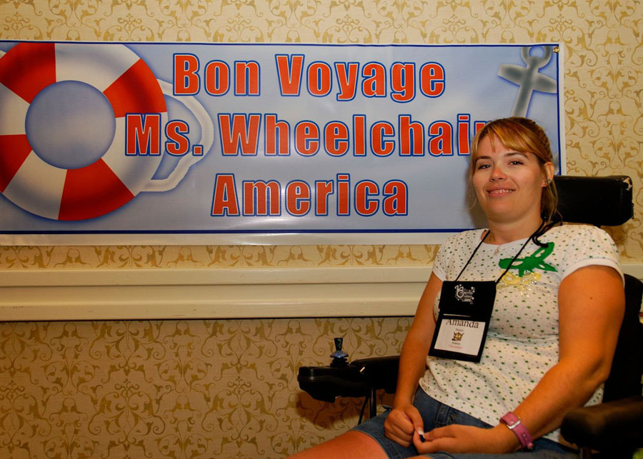 Amanda poses in from of Bon Voyage sign