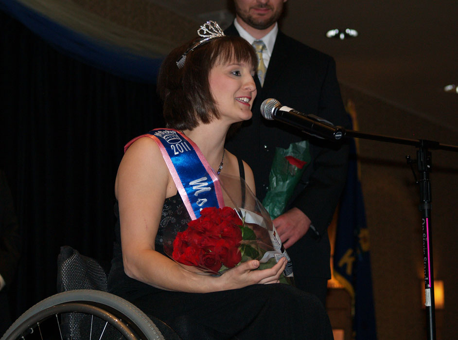 Jenny speaks into microphone after being crowned
