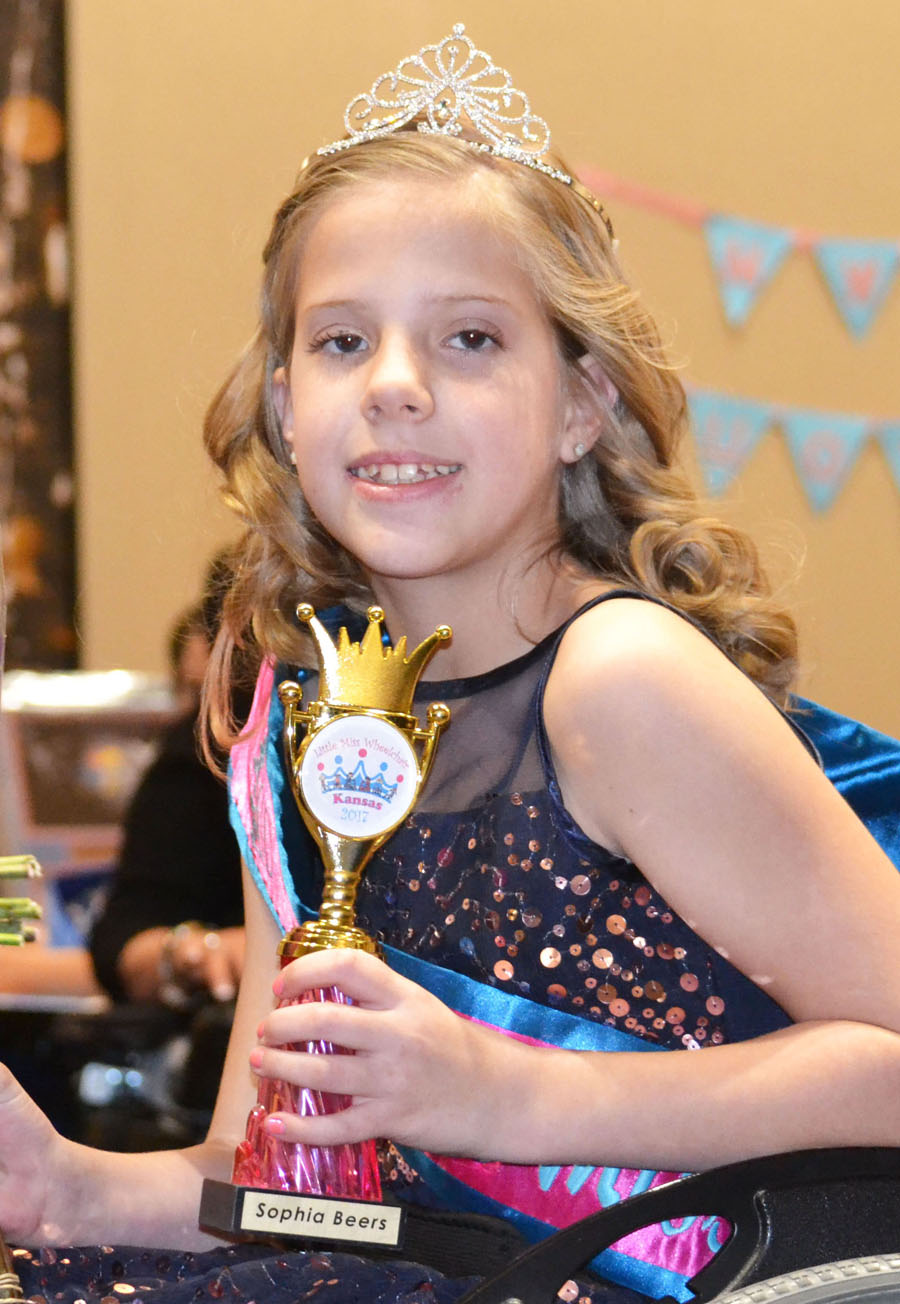 Sophia wearing her crown and sash with her trophy